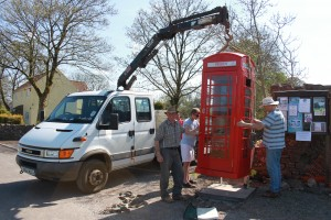 Locals restoring the Defibrillator Phone Box in 2013